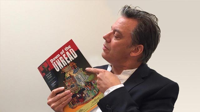 Paul Fillingham with the book version of Dawn of the unread